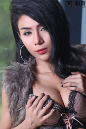 Alluring Asian Girl Stripping