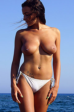 Busty Brunette Gets Topless